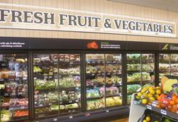 The fresh fruit and veg chiller units at the front of the store